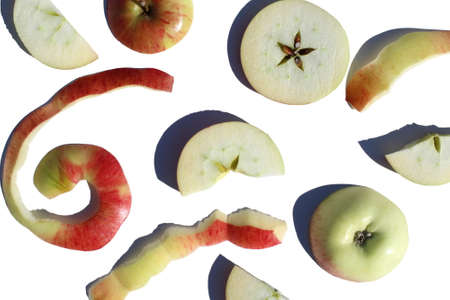 Apple sliced and peeled lies on a white background