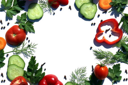 Chopped vegetables in a circle lie on a white surface Archivio Fotografico