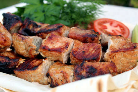 Grilled meat with pieces and vegetables Stock Photo