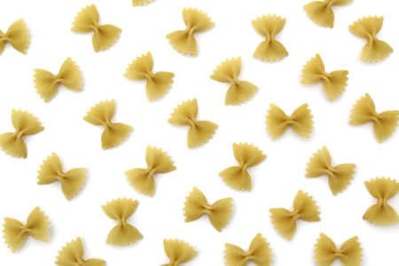 Texture of pasta in the form of a bow on a white background Stock Photo
