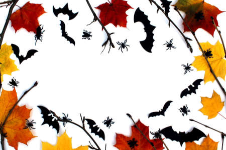 Halloween card with autumn leaves, branches, bats and place for text