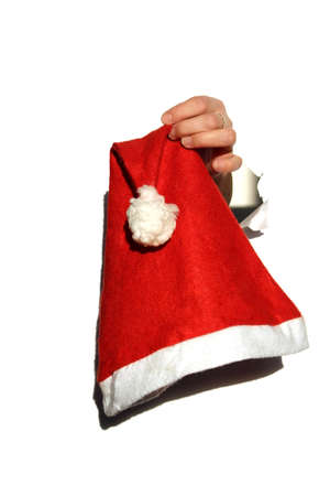 Decorative little red riding hood hanging in a woman`s hand for a christmas holiday
