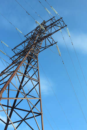 High voltage pole stands against the blue sky Reklamní fotografie