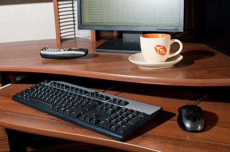 work table with PC, phone and cup of tea Stock Photo