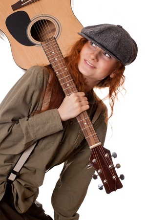 nice young girl whith guitar on her shoulder