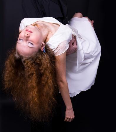 redhead girl unconscious