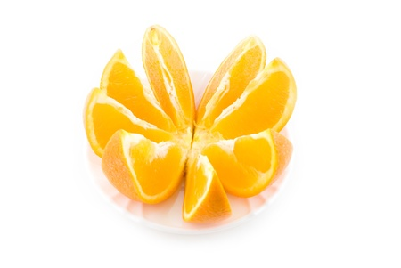 cut orange on the white