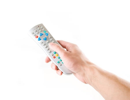 remote in a hand on the white Stock Photo