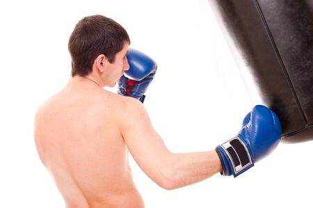 young beats a boxing bag