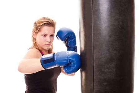 girl beats a boxing bag