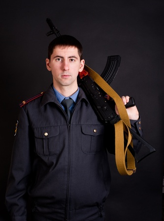 man in uniform holding gun Stock Photo - 8487741