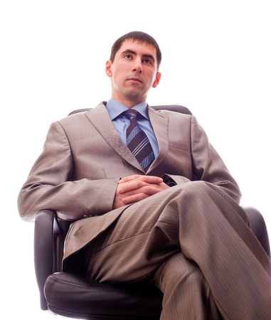 chear: man sitting in a chair