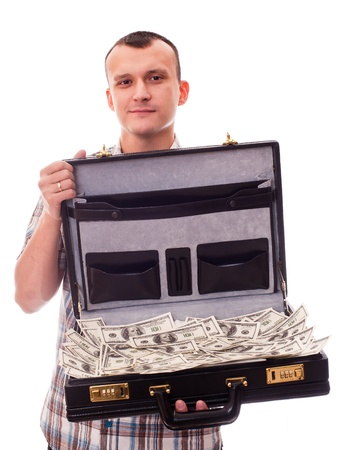 young man with suitcase full of money Stock Photo