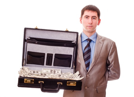 a lot of money: young man with suitcase full of money Stock Photo