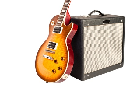 guitar tuner: guitar and amplifier (isolated on white)