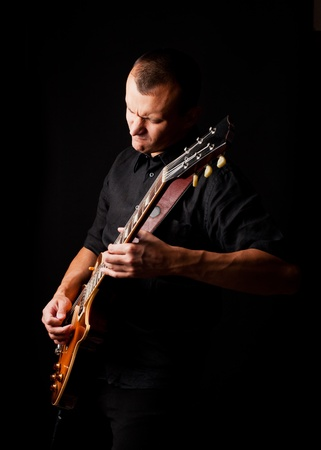 solo: man playing guitar Stock Photo