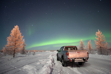 car and northern lights