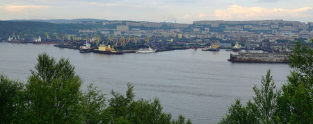 Panoramic view of Kola bay and Murmansk with its busy sea port.
