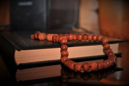 The holy Quran with rosary beads