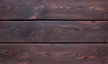 Dark brown scratched wooden cutting board.