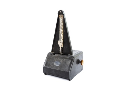 old metronome isolated on white background photo