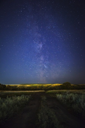 road and the Milky Way at night photo