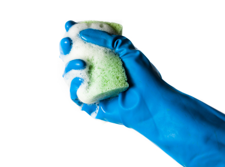 sponge for washing dishes in hand, washing dishes isolated on a white background photo