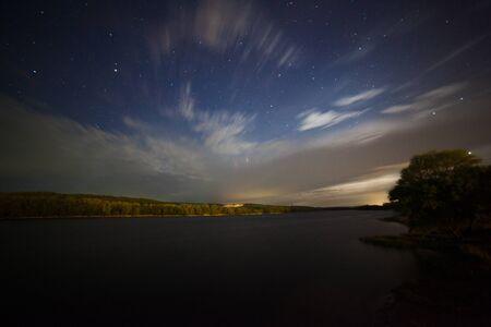 beautiful night landscape, moonrise, lake and trees photo