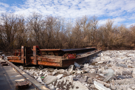 old rusty barge on a river