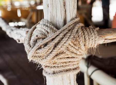 wooden structure with a thick rope closeup Stock fotó