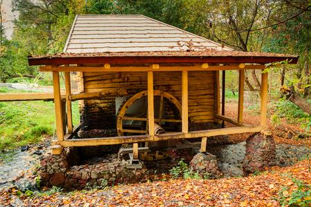 秋の森の水車 写真素材