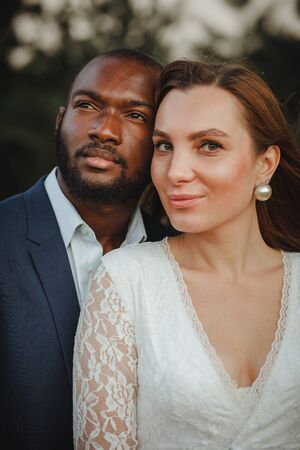 happy and beautiful mixed ethnicity couple with beautiful afro American man and cheerful european woman