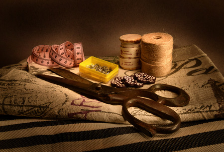 Sewing materials, vintage fabrics with old scissors and hemp string