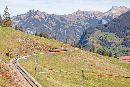 Panoramatic view of Jungfrau Region with incoming train from Gruetschalp (Grütschalp) near Winteregg, Jungfrau Region, Switzerland