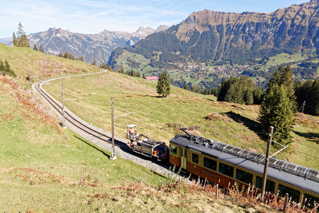 Panoramatic view of Jungfrau Region with incoming train from Gruetschalp (Grütschalp) near Winteregg, Jungfrau Region, Switzerland Reklamní fotografie