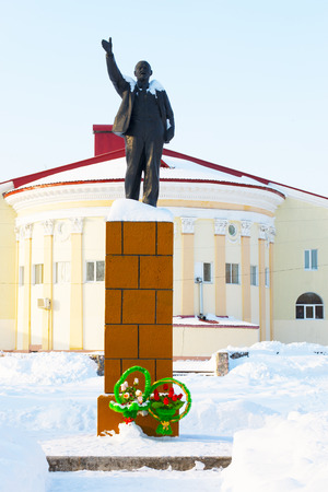 male likeness: monument to Lenin in the winter time