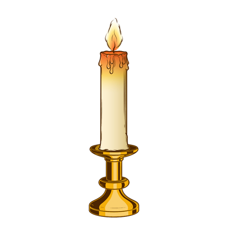 Burning old candle and vintage brass candlestick isolated on a white background.