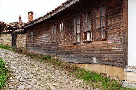 folk village: Street with cobble stones of folk museum Zheravna village in Bulgaria. Mountain village. Editorial