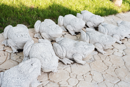 Limestone Statues Of Frogs. Stone Walkway. Frogs On Alley In Beautiful  Garden With Flowers
