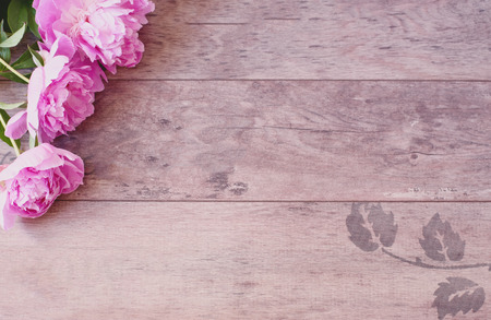 stock photography: Pink Peonies Flowers on a Wooden Background. Styled Marketing Photography. Styled Stock Photography. Blog Header Image Blog Stock Photo