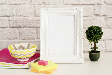 stock photography: Frame Mock up. White Frame mockup. Styled Stock Photography. Notebooks, Bonsai Plant. Template Product Mock-up. Empty Frame on Brick Wall. White Vertical Frame on Gray Wall, Office Desk Accessories