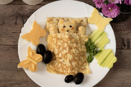 baby rice: Creative idea for kids snack, breakfast or lunch. Sleeping bear from bulgur, rice and quinoa under the blanket of egg omelet. Flowers and butterflies with cucumber, sandwiches of cheese and bread. Fun and healthy kids meal. Art of food