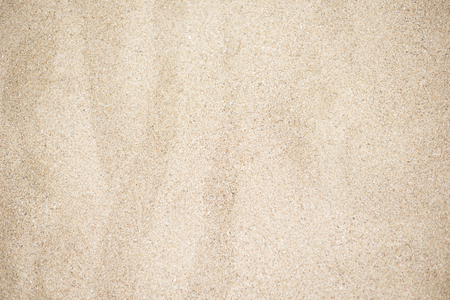 Beach sand background. Beautiful texture of golden sand photographed in close-up Stock Photo