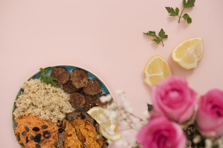 Healthy food concept. Clean eating. Meal with turkey meatballs, bulgur, sweet potato, carrot, salad. Pink and gold concept. Low carb eating, light lunch, fitness menu