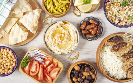 Iftar food table. Evening meal for Ramadan. Arabic cuisine. Middle Eastern traditional lunch. Assorted of Egyptian oriental dishes. Top view 写真素材