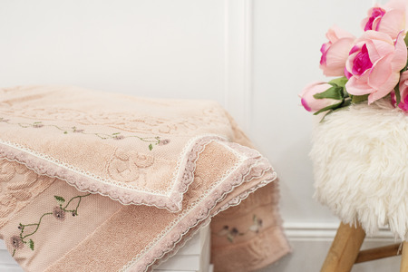 Towels with lace. Flowers on background Imagens