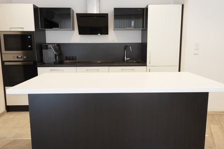 Modern new light interior of kitchen with white and black furniture Reklamní fotografie