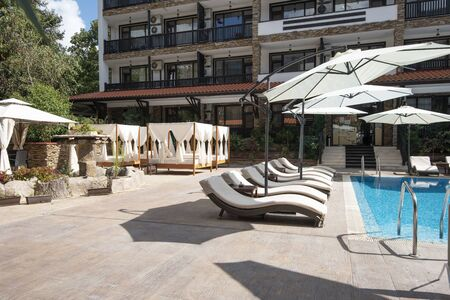 Swimming pool of luxury hotel with umbrella and chair around. Hotel resort in Bulgaria, Primorsko for travel and summer vacation