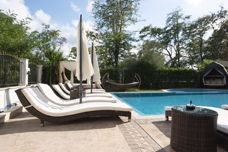 Summer vacation. Swimming pool of luxury hotel with umbrella and chair around. Hotel resort in Bulgaria, Primorsko for travel Reklamní fotografie
