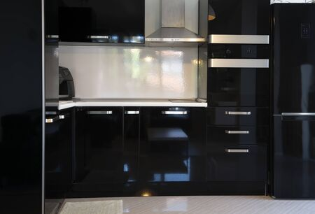 Close up of kitchen interior with black furniture 写真素材